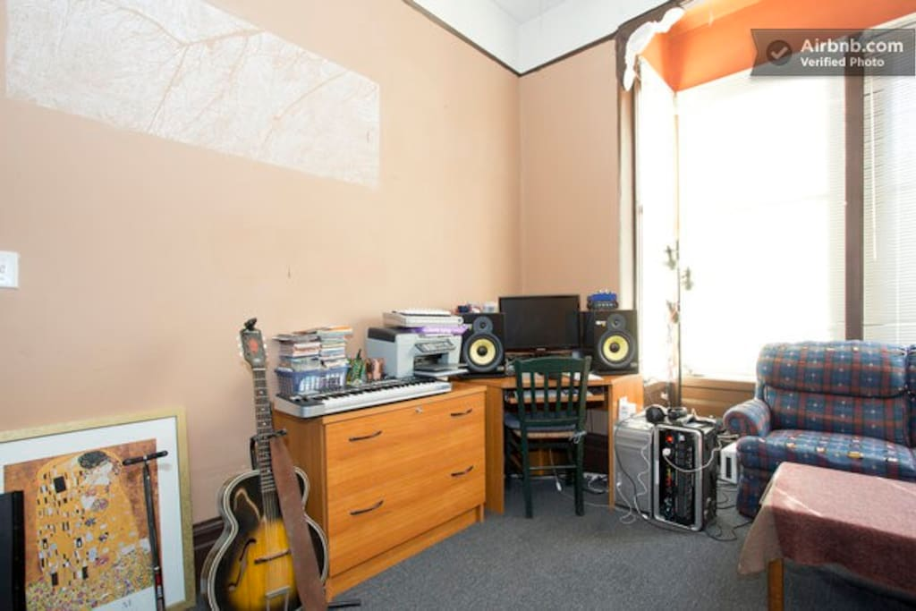 a view of the room from the bed - it is also a recoding studio