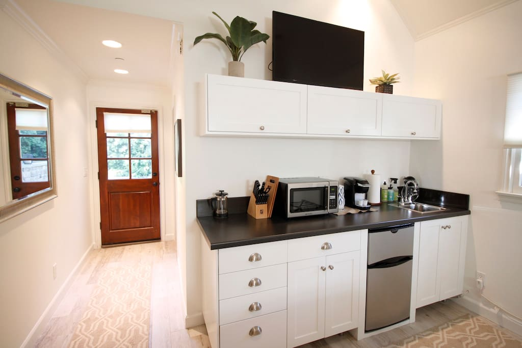 Kitchenette featuring all amenities, microwave and refrigerator.