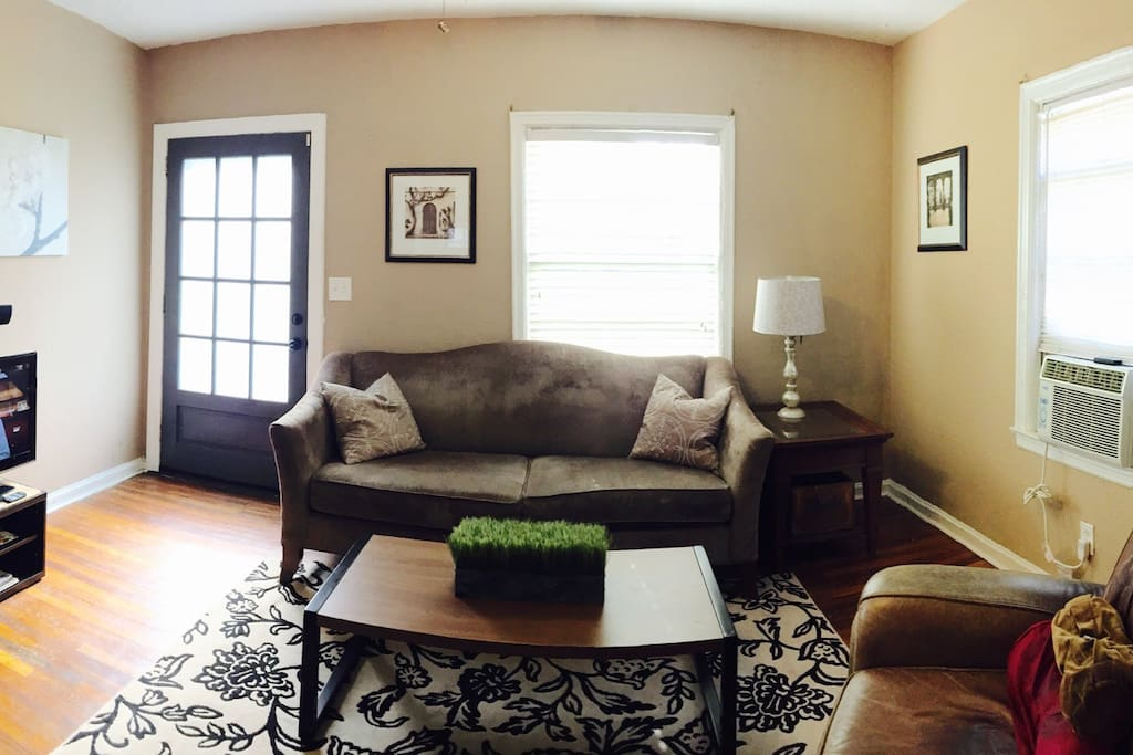 Cozy living room with plush couch and leather recliner that fits like a glove