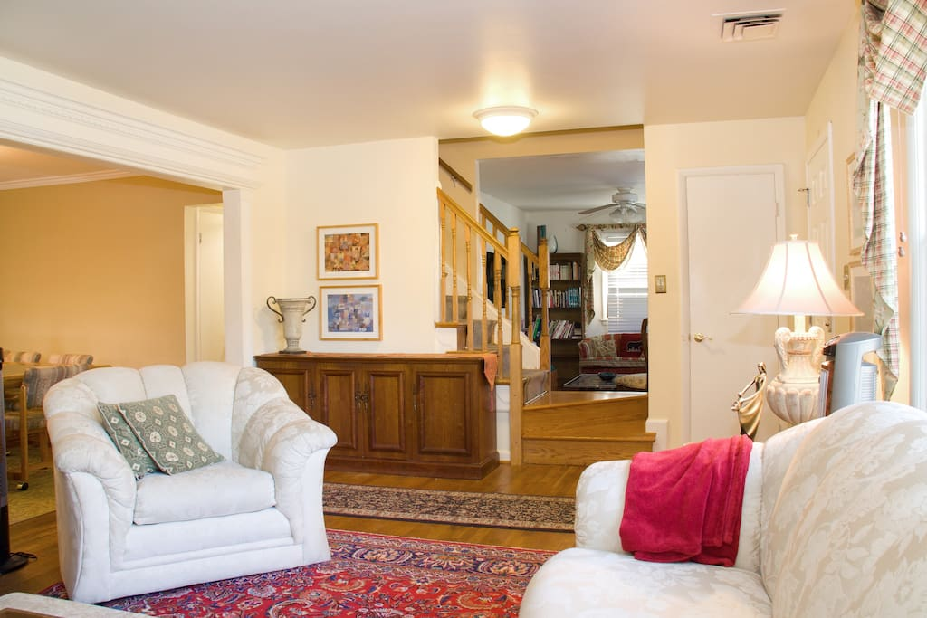 From living room, straight ahead is the Family room, dining on the right