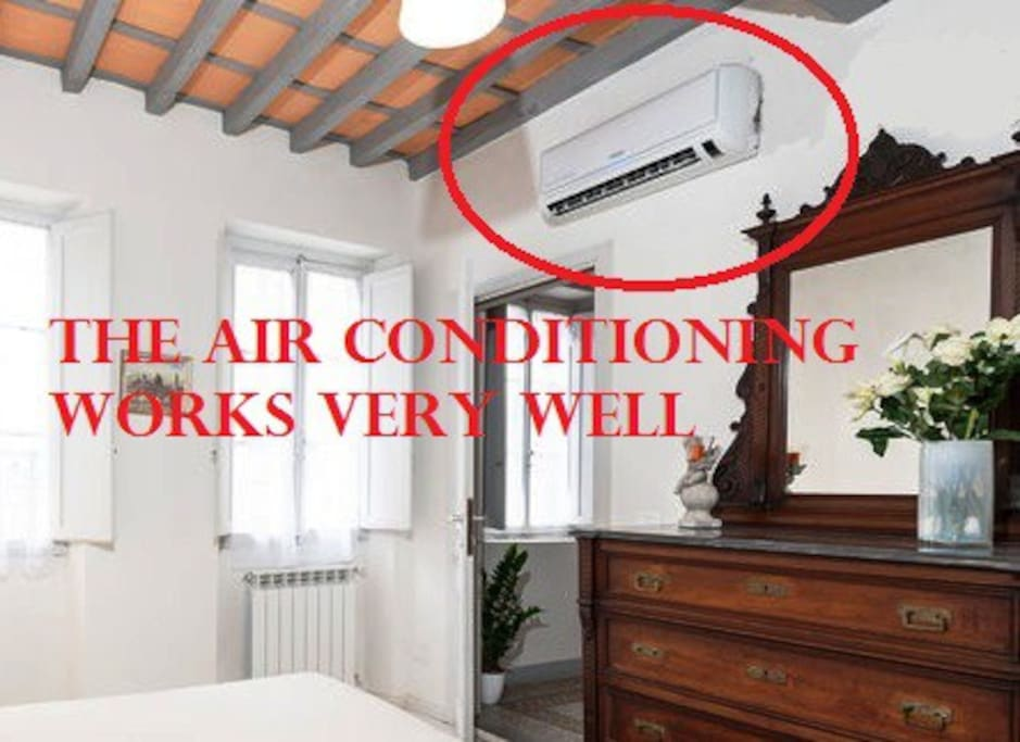 THE AIR CONDITIONING IS NEW AND WORKS VERY WELL