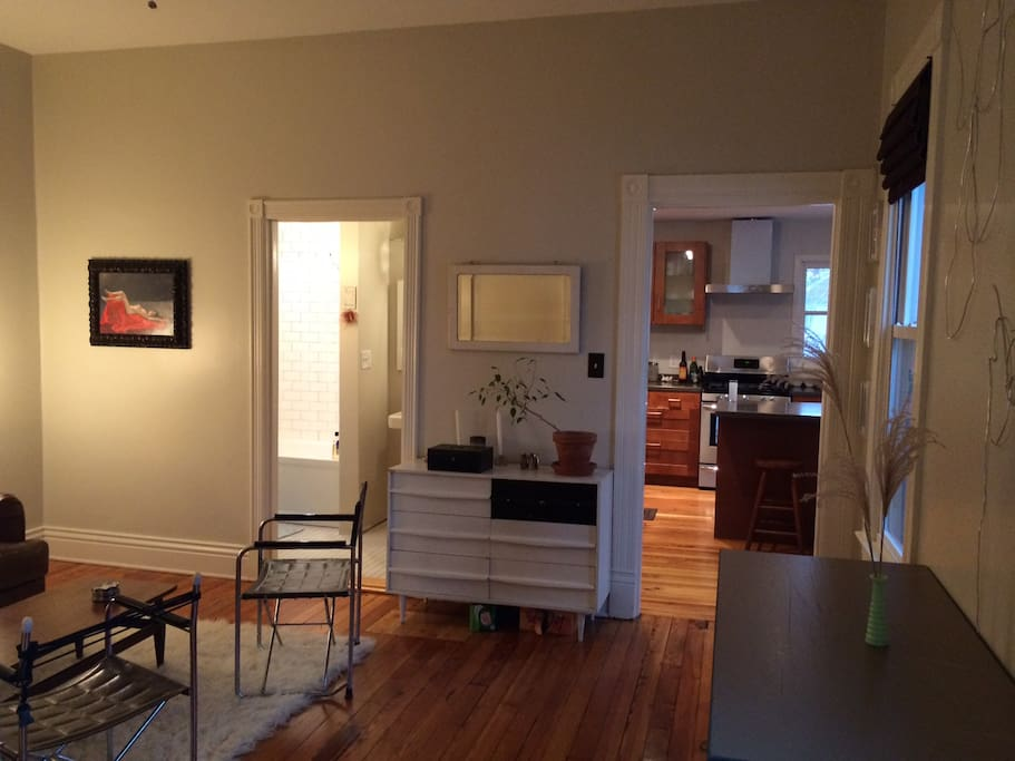 living room (looking in from the master bedroom). Full bath ahead to the left and kitchen to the right.