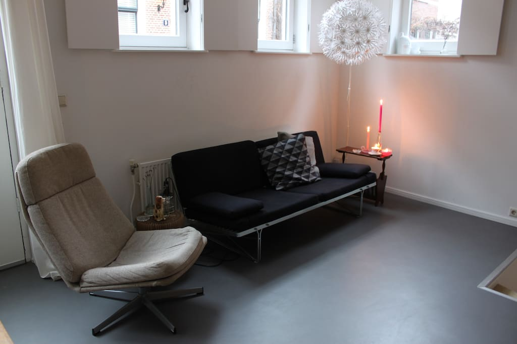 Comfortable sitting area, where you can enjoy one of our many films or books.
