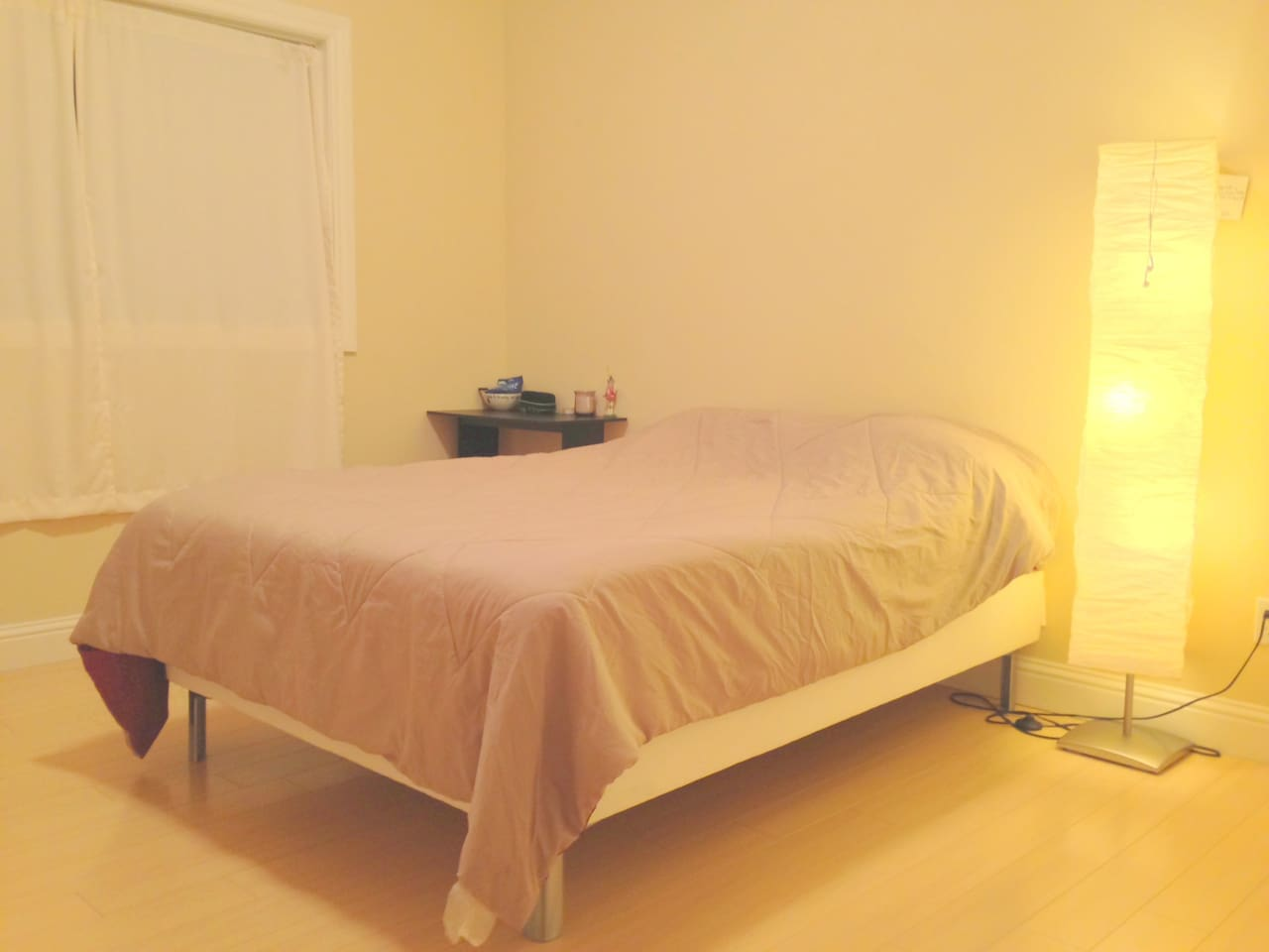 This room has one queen bed as well as one twin bed. Great for a couple or two/three friends.