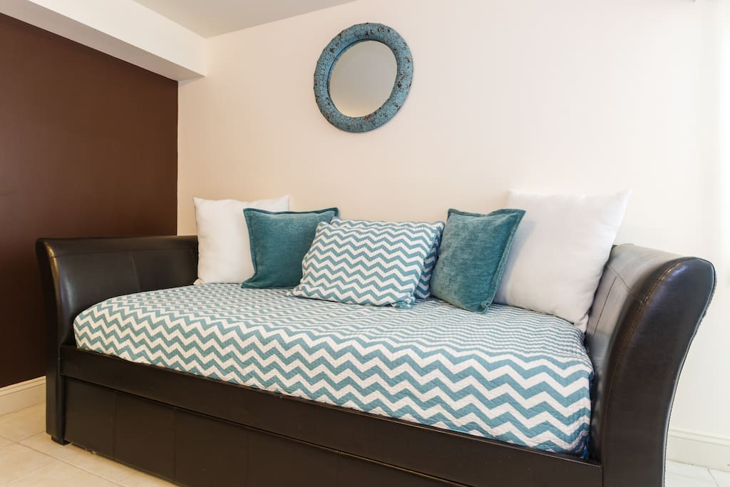 This day bed inside the bedroom has a trundle bed. (it converts to 2 twin beds)