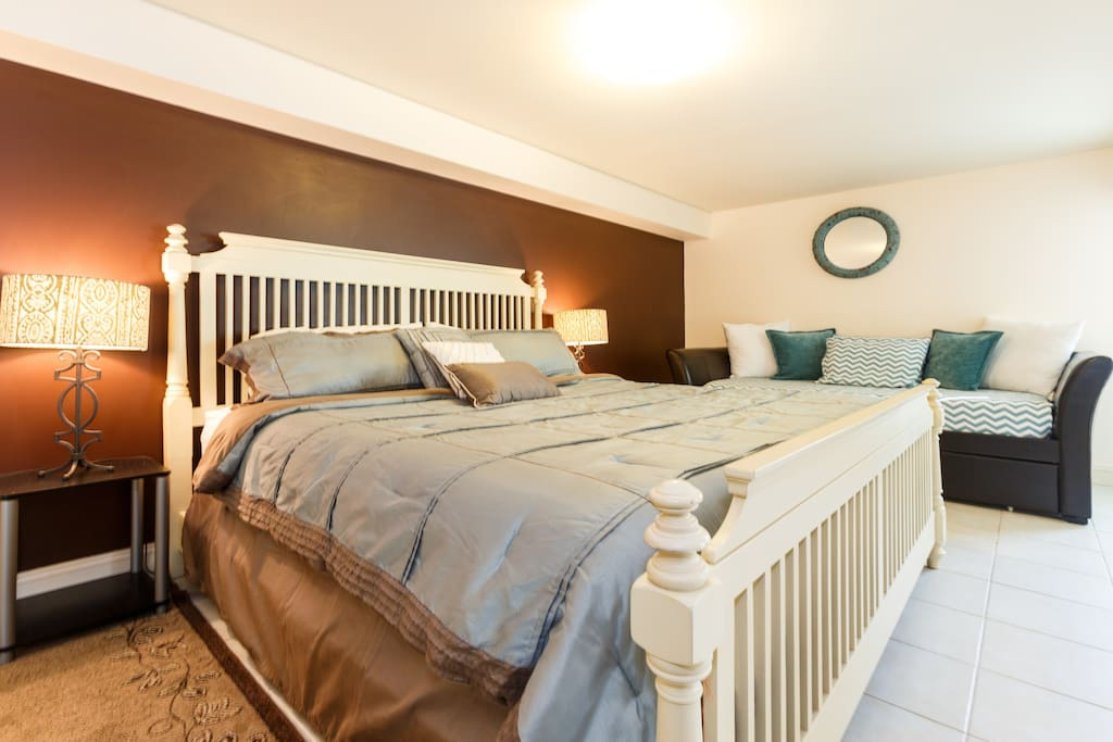 The bedroom is big enough to have a KING size bed and a double day bed
