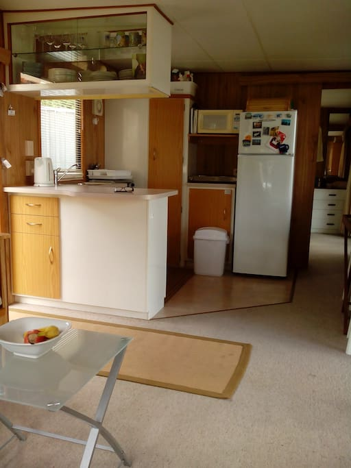 Kitchen- compact but has everything required. Toaster, electric frypan, 2 burner stove top, mini oven, Griller etc