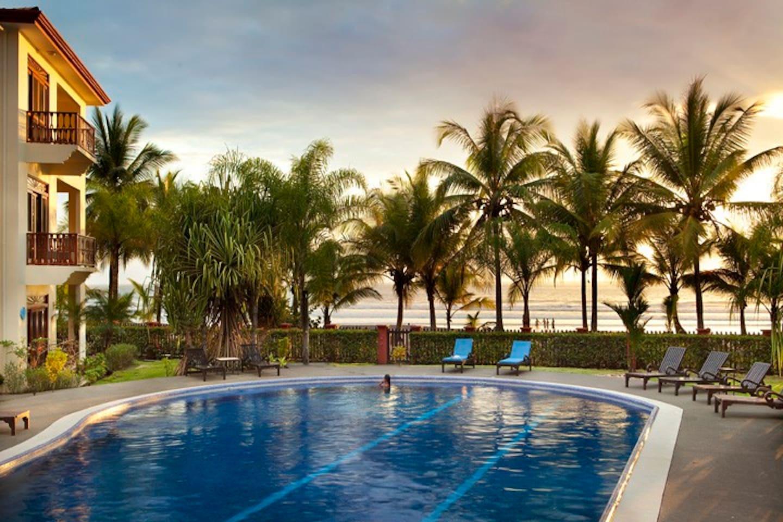 Ocean front pool at sunset in Bahia Azul