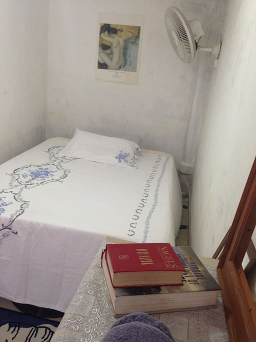 Double Bedroom with wall fan and air conditioning