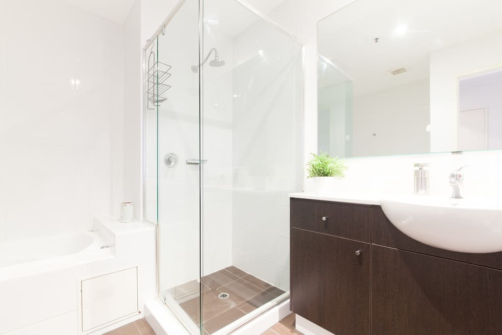 Large private bathroom with deep spa bath and separate shower