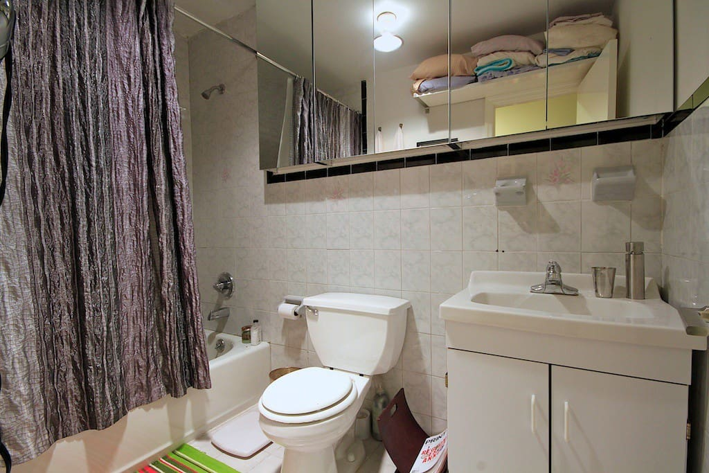Your own private full bathroom with plenty of counter space for your toiletries.