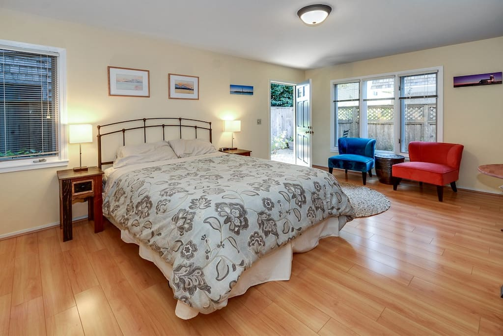 Very comfy queen size bed with mattress warmer pad, plus seating area for two.
