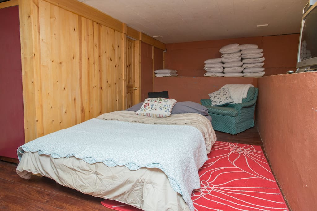 Basement bedroom with a futon that sleeps 1-2! There are a few windows, good heater and cable tv.