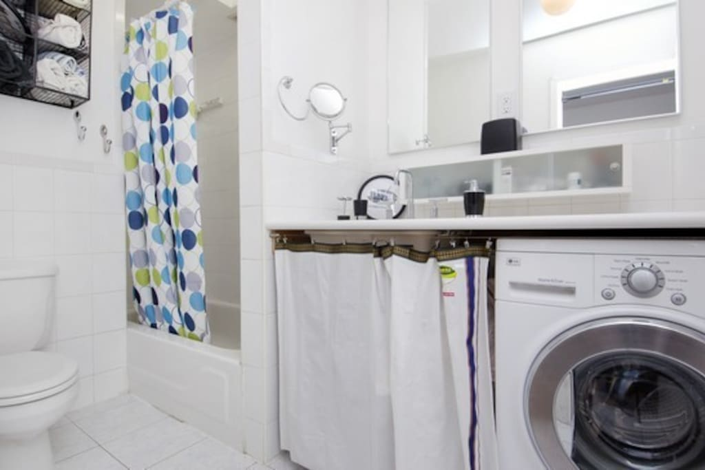 Bathroom with HR combo washer/dryer.  See floor plan for more.