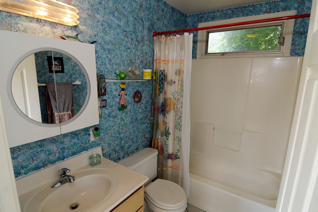 The full bath is in the nall next to the room. It may be shared with only one other room.