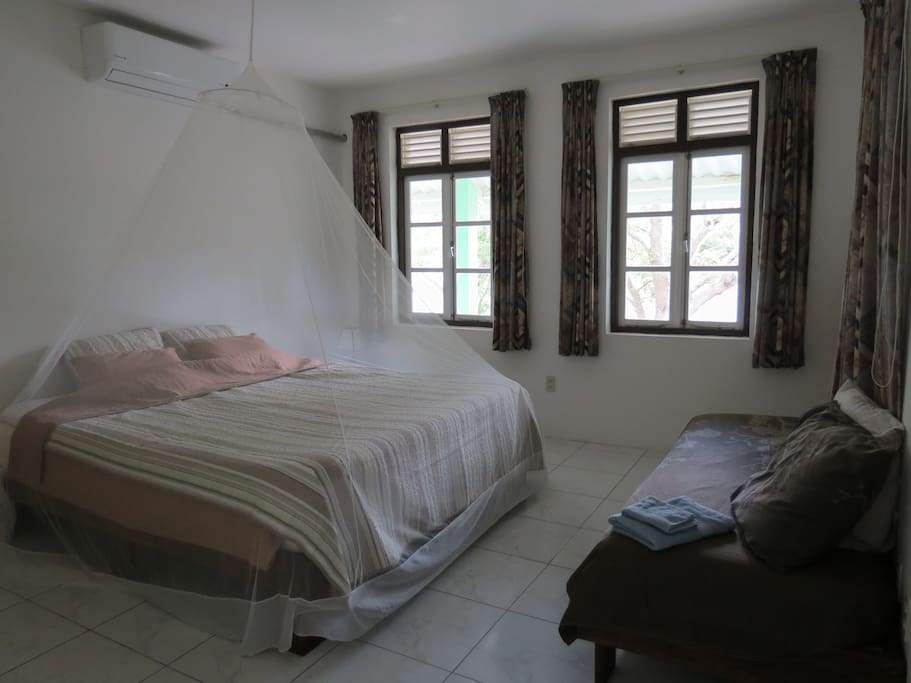 Bedroom with king size bed, air conditioning and safe.