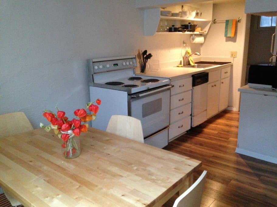Spacious kitchen and dining area. Basic cookware and place settings provided.
