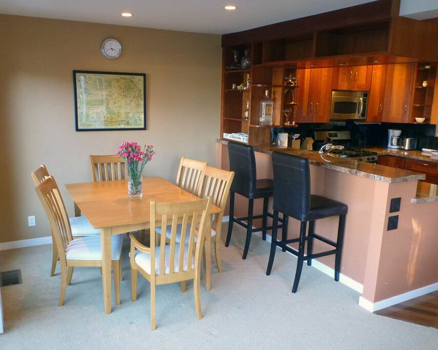 DINING ROOM TABLE EXTENDS TO SEAT 8
