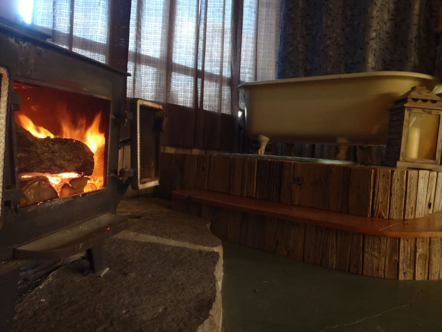 Crackling fire in the cabin. Complimentary firewood is provided.