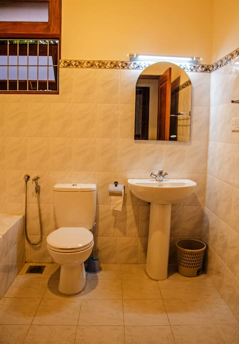 There are 3 bathrooms with modern fittings & one has a bath