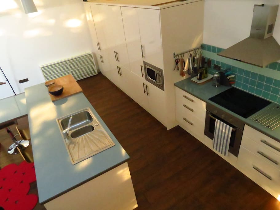 modern kitchen with electric cooker, microwave, dish washer, fridge, washing machine, tumble drier, natural gas central heating