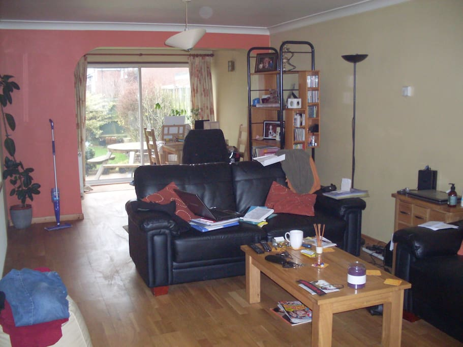 Large Open lounge/diner with dinning table, TV, coffee table and sofas