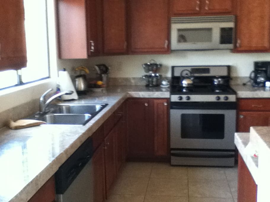 Breakfast daily for guests. Bright large open kitchen space with views to living room and outdoors.