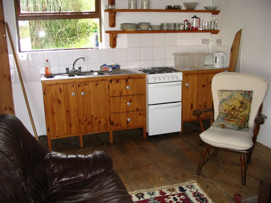 Kitchen area with full size oven.