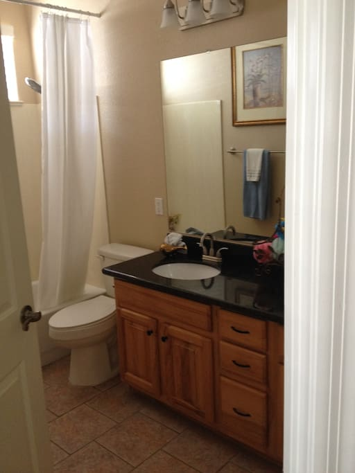 2nd of 2 bathrooms with bathtub, shower, and two sinks