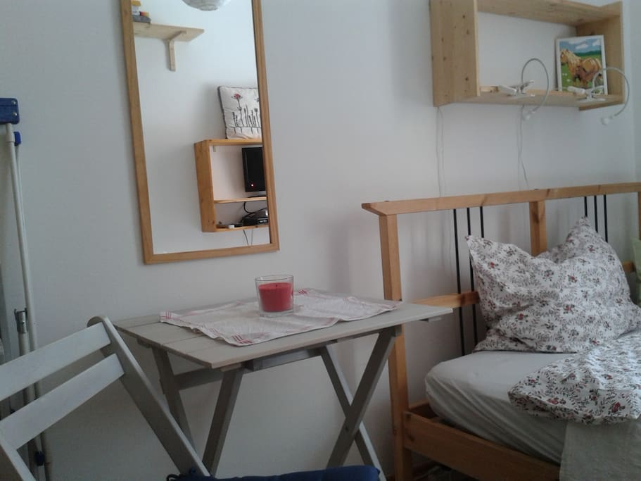 Table in the guestroom with two chairs.