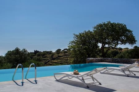 Villa Oliva in Kea | pool - view - petanque court - Hus