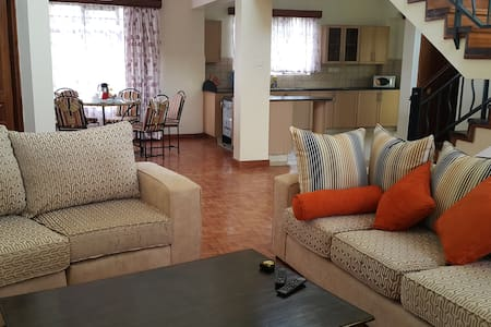A spacious en-suite bedroom in a beautiful and equally spacious duplex penthouse on Ole Dume road, Nairobi Kilimani area, shared with wonderful housemates waiting to welcome you to share in the joy of the place they are so proud to call home.