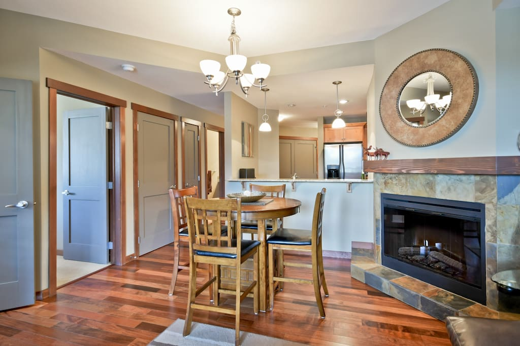 Beautiful hardwood flooring and trim, cozy fireplace too