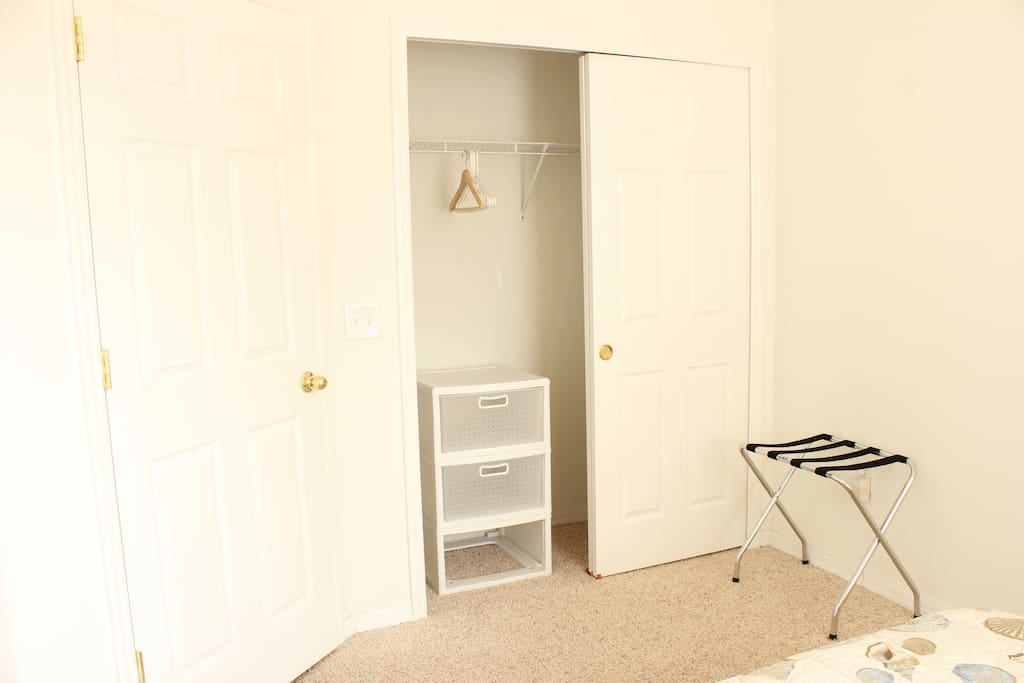 The bedroom also has drawers, plenty of hangers, and a luggage rack.