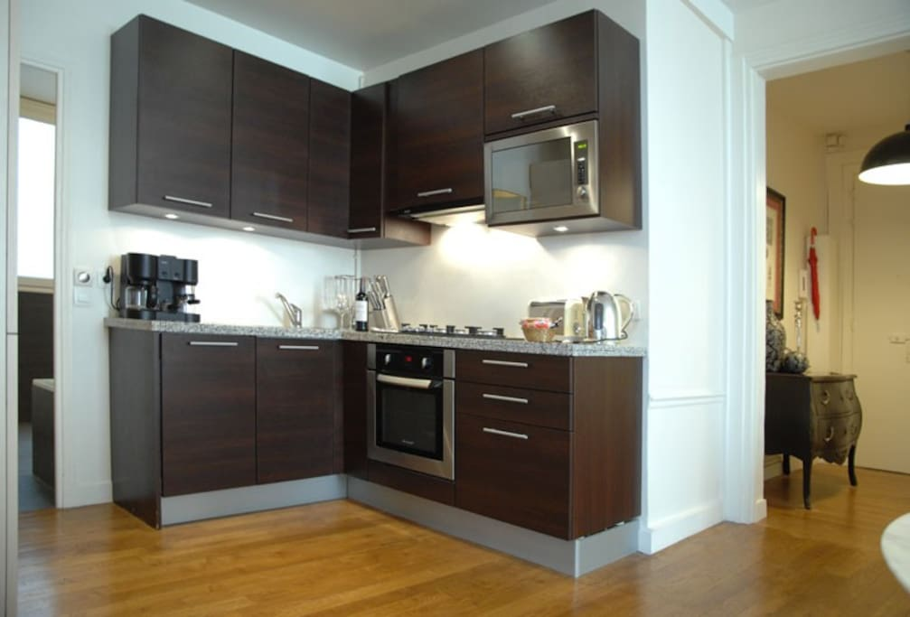 Modern kitchen with granit counter top, oven, microwave, large fridge and separate freezer, dishwasher...
