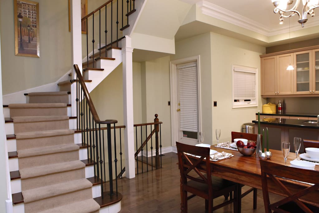 Dining area, kitchen and stairs to upper floors
