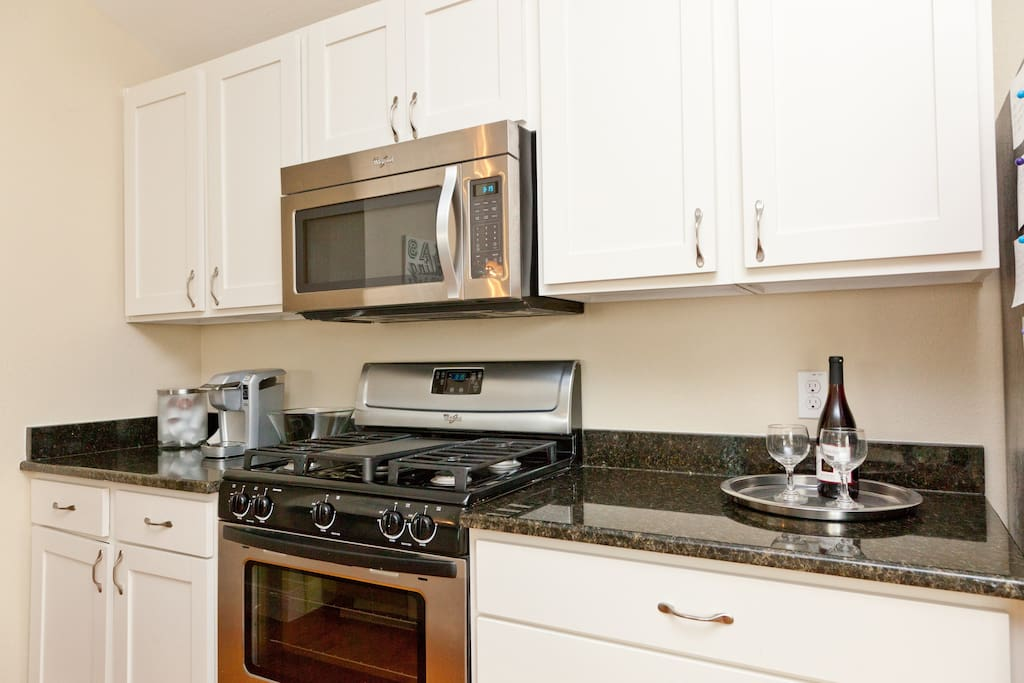 Open, spacious kitchen.  Fully-stocked with everything you might need during your stay.