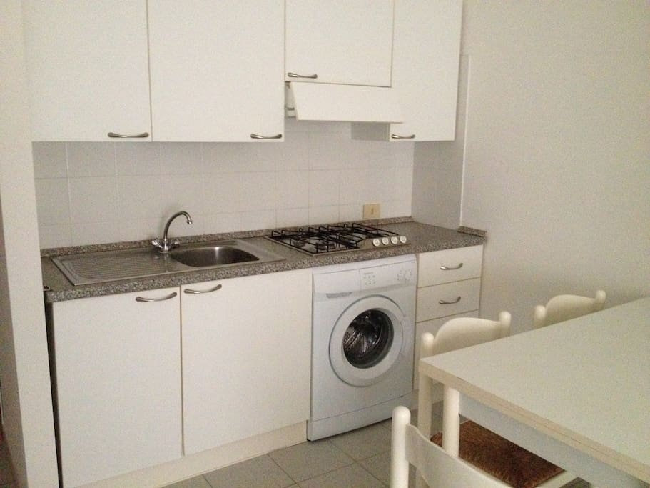 fully equipped kitchen with brand new washing machine