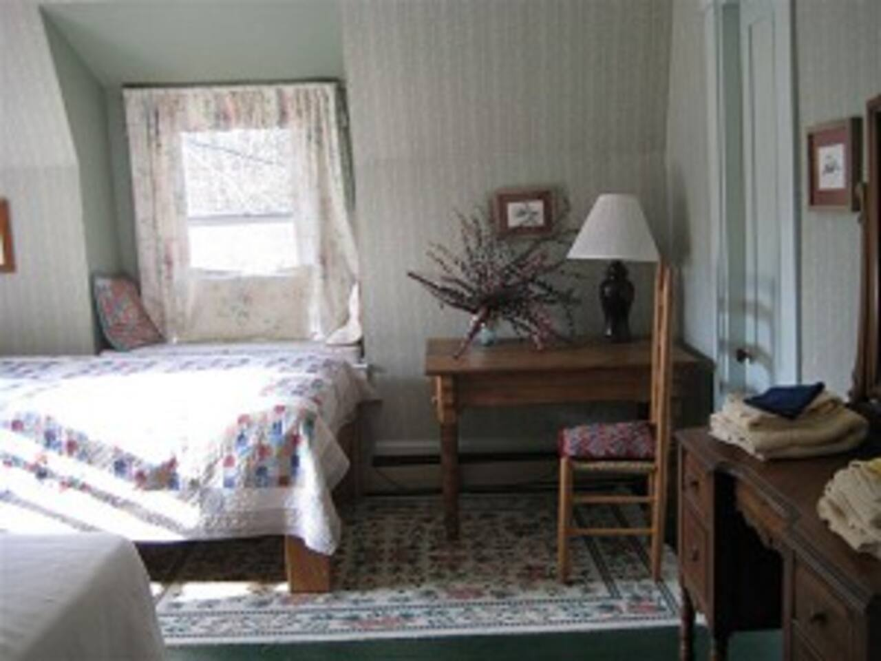 This room is on the second floor, and has one full bed and one twin bed.
