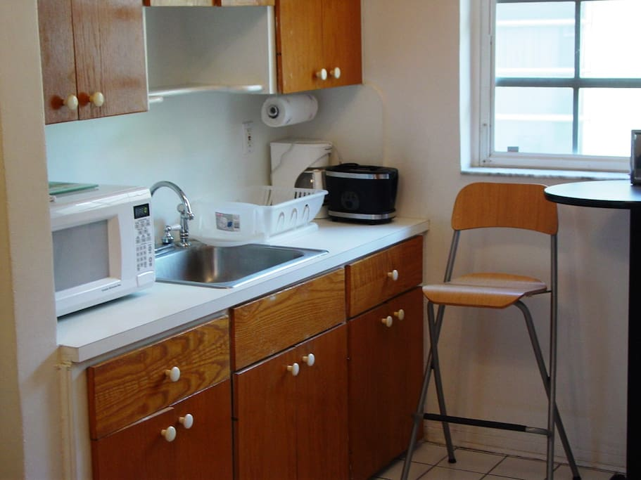 Kitchen with refrigerator, stove and microwave