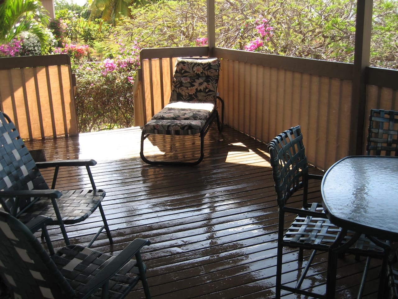 Private covered deck with garden view