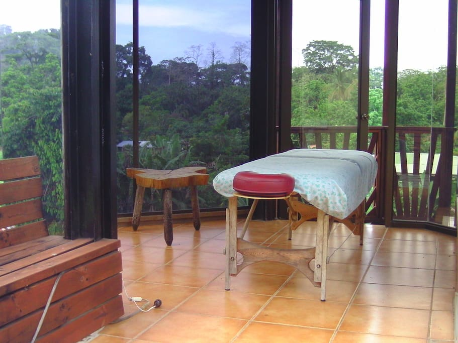 The massage room has views over the mountains and the ocean.  Just relax!