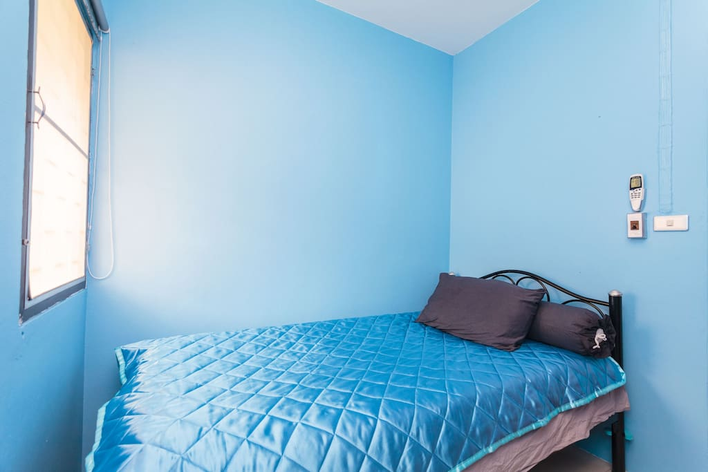 Welcome home! A nice, soft, new bed with a great air conditioner and a UV blocking window shade to let you sleep in.