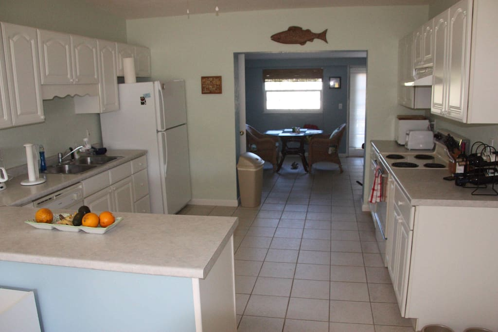 Fully equipped kitchen includes dishwasher, oven/range, refrigerator with ice-maker.