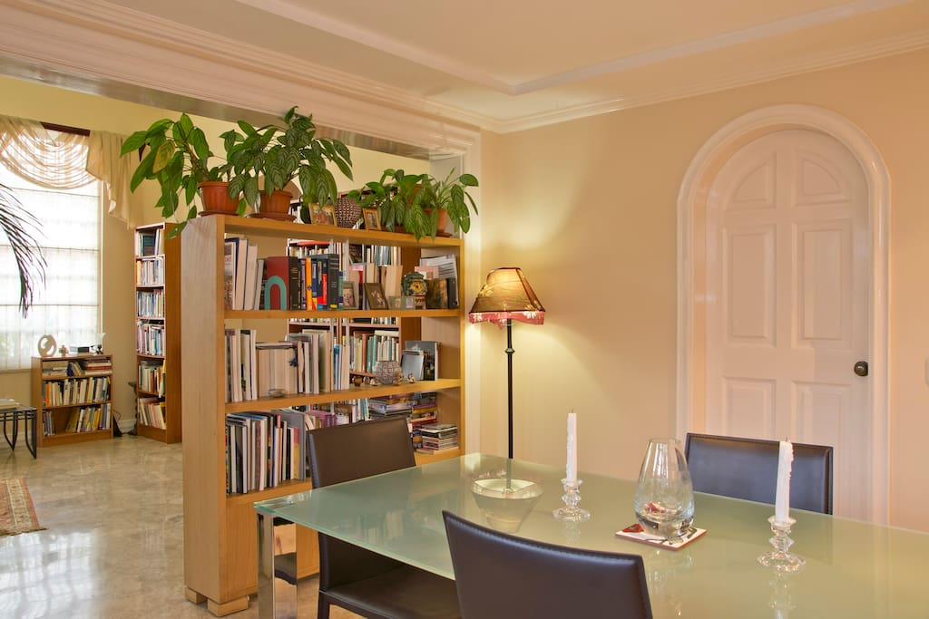 Dining room and living room, all rooms have books to share and enjoy