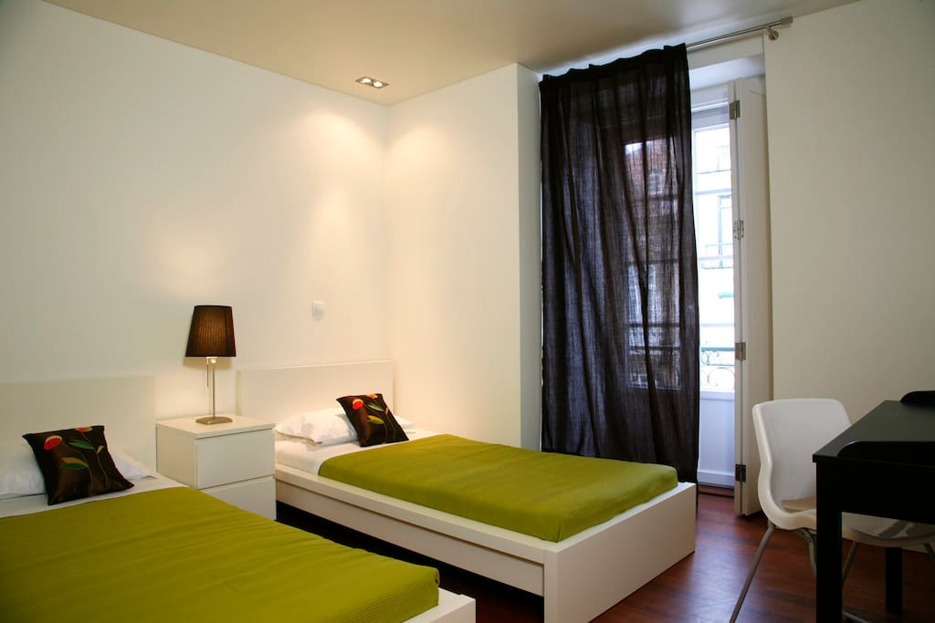 One bedroom with two single beds