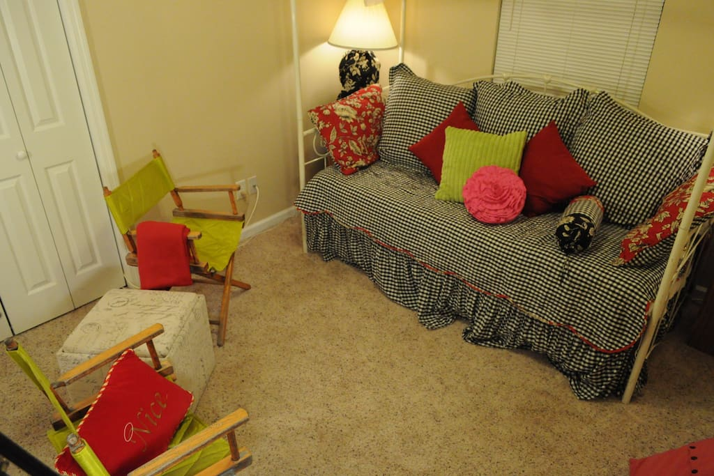 Second room set up as sitting room with TV. Trundle bed available to couple with the twin day bed for extra guests