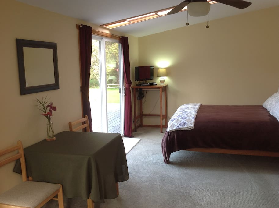 Spacious bedroom with a queen bed overlooking a beautiful lily pond.