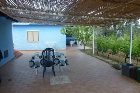 Bilocale con giardino Capo Comino - Orosei