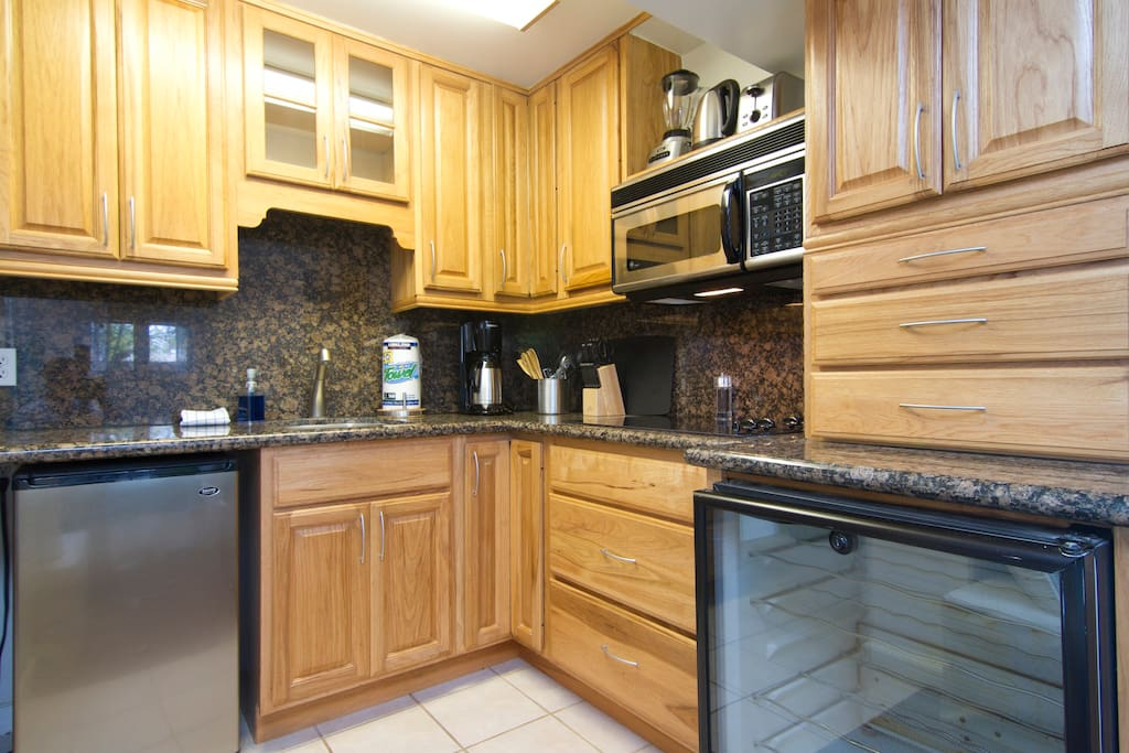 Complete kitchen with oven/microwave, 4 burner electric cooktop, wine captain, blender, toaster, coffee maker, electric tea kettle, etc.